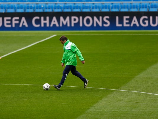 Wolfsburg's head coach Dieter Hecking plays the ball during a training session at the Santiago Bernabeu stadium in Madrid, Monday, April 11, 2016. Wolfsburg will play a Champions League soccer match against Real Madrid on Tuesday 12. (AP Photo/Francisco Seco)