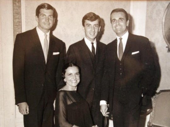 From left to right, George, Bill and David Hamilton with their mother, Teeny.