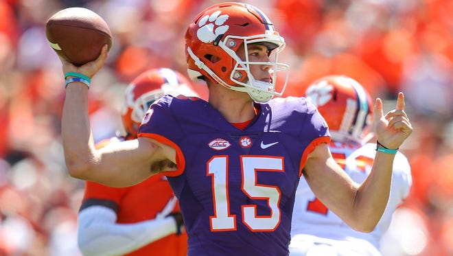 Clemson quarterback Hunter Johnson (15) throws during the spring game on Saturday.