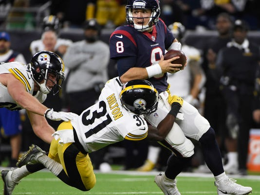 Houston Texans quarterback Taylor Heinicke (8) is tackled for a loss by Pittsburgh Steelers defensive back Mike Hilton (31) during the second half of an NFL football game Monday, Dec. 25, 2017, in Houston. (AP Photo/Eric Christian Smith)