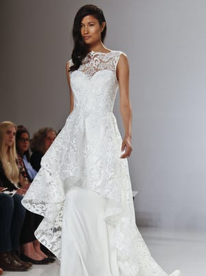 Christian Siriano's bridal collection modeled April 18 in New York offered a range of hem lengths, from well above the knee in an appliqued mini to a fitted tea length with an ornate high neck and dramatic train.
