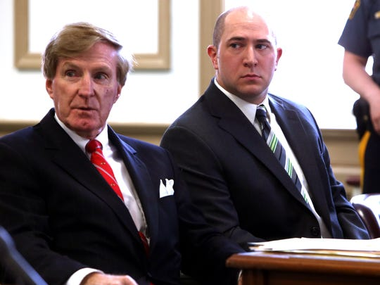 Defense attorney Gerard Hanlon, l, with former Madison Patrolman Chad Rybka in Morris County Superior Court where Rybka plead guilty to third degree endangering the welfare of a child by possessing nude images of a 17-year-old girl.  May 26, 2016, Morristown, NJ