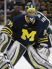 Michigan goalie Zach Nagelvoort guards the net during the second period of an NCAA college hockey game against Michigan State, Friday, Jan. 30, 2015 in Detroit.