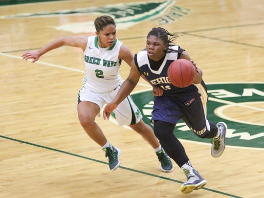 Fort Myers Jarya Outten (2) defends against Leigh's Alesha Curruy (13) during the ladies basketball game at Fort Myers High School in Fort Myers, FL on Friday, January 29, 2016.  Fort Myers defeated Lehigh to win the Deistrict 6A-11 Championship.  Photo by Gregg Pachkowski