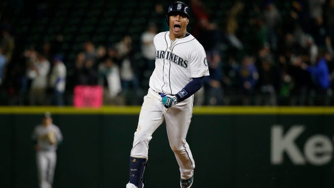 Seattle Mariners' Leonys Martin yells as he rounds the bases after hitting a two-run walk-off home run in the ninth inning of a baseball game against the Oakland Athletics, Tuesday, May 24, 2016, in Seattle. The Mariners won 6-5. (AP Photo/Ted S. Warren)