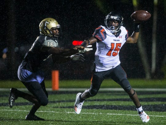 Lely quarterback Jonis Dieudonne (15) throws the ball under pressure against Golden Gate last year.