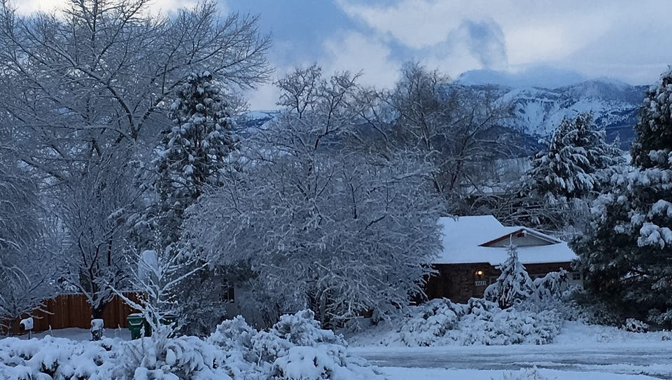Snow piles up in a residential area of South Reno on