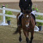 Kyle Dutiel competes in the Dressage event at the Special Olympics world games on Thursday