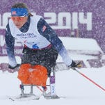 The United States' Oksana Masters, a Louisville resident, races during the semifinal of the women's cross country 1-kilometer sprint event at the 2014 Winter Paralympic Games on Wednesday in Krasnaya Polyana, Russia.