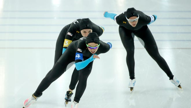Brittany Bowe (1), Heather Richardson (3), and Jilleanne Rookard (4), all of the USA, skate in the Speed Skating ladies' team pursuit quarterfinals during the Sochi 2014 Olympic Winter Games at Adler Arena Skating Center.
