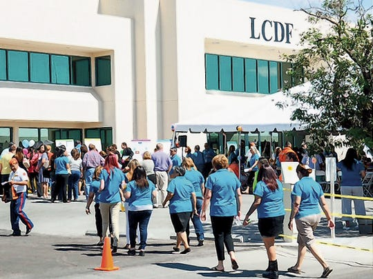 Many gather for the La Clinica de Familia meet and greet Sept. 16 at its mental health facility on Griggs Avenue. The agency took over Medicaid-funded behavoiral health care in early August
