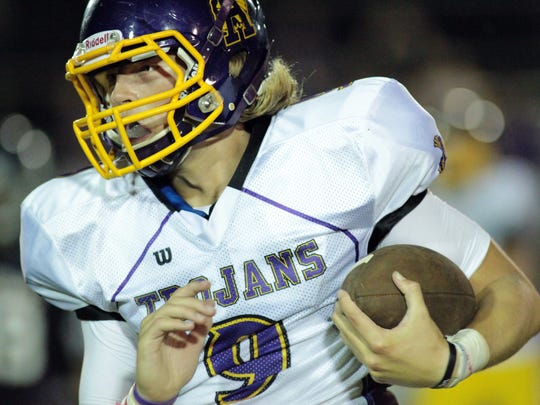 Alexandria Senior High quarterback Matthew Beck runs with the ball in a high school football game Friday, September 12, 2014, at Comeaux High School in Lafayette, La.