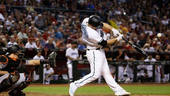 Arizona Diamondbacks Chris Iannetta hits a grand slam against Miami Marlins in the 6th inning at Chase Field on Friday, Sep. 22, 2017 in Phoenix, Ariz.