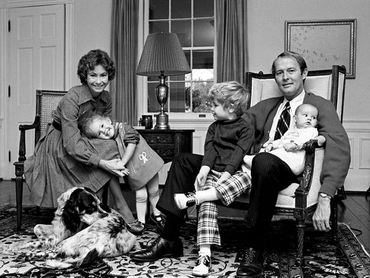 Republican gubernatorial candidate Lamar Alexander and wife Honey spent some time with their children and pet after voting and waiting for the polling places to close on Nov. 5, 1974.