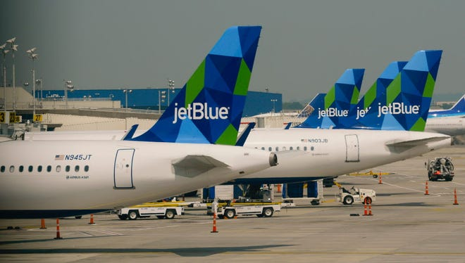 Jet Blue planes at gates at New York's John F. Kennedy Airport on June 11,  2015.