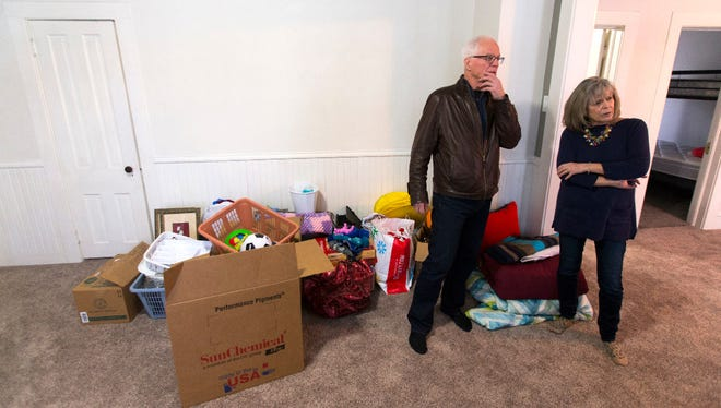 Richard and Kathy Manny are shown in the Sheboygan home they were going to rent to a Syrian refugee family.The items behind them were for that family.