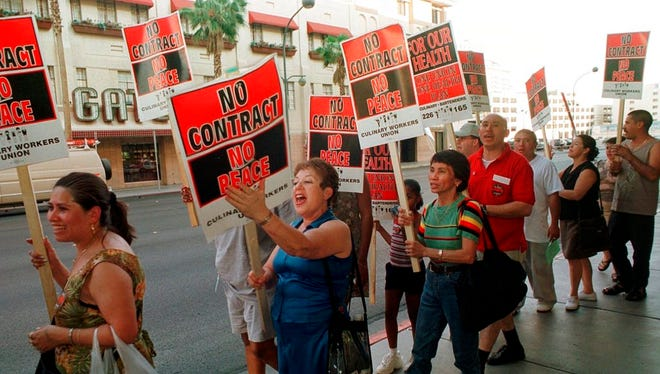 In this June 30, 2002 file photo, members of the Culinary Union Local 226 picket outside the Plaza hotel-casino in Las Vegas hours before their contract was to expire. Fifty thousand unionized Las Vegas casino workers whose contracts will expire at the end of the month are set to vote on whether to go on strike. The Culinary Union on Wednesday, May 9, 2018, said it will hold a strike vote May 22 at a university arena.