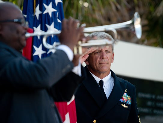 National Navy UDT-SEAL Museum Executive Director Rick Kaiser, retired Navy SEAL BMCM, salutes during the playing of taps at the museum's Memorial Day service May 29, 2017, in Fort Pierce. This year's ceremony is 9-10:30 a.m. May 28 at the museum at 3300 N. SR A1A in Fort Pierce.