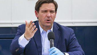 Florida Governor Ron DeSantis speaks at the Miami Beach Convention Center to discuss the U.S. Army Corps' building of a coronavirus field hospital inside the facility on Wednesday, April 8, 2020. The governor's Re-Open Florida Task Force met Tuesday to discuss how to end the statewide lockdown and restart the economy.