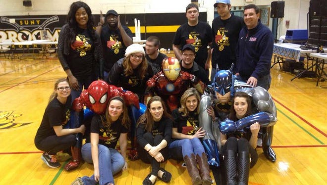 """SUNY Broome students pose with """"Souper-Heroes"""" at last year's Clash of the Souper-Heroes fundraiser to benefit Mom's House, an organization in Johnson City that provides free licensed daycare services to parents trying to earn degrees."""