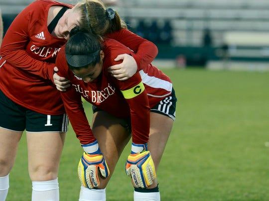 Nicole Manderson hugs teammate Margeaux Hunt after