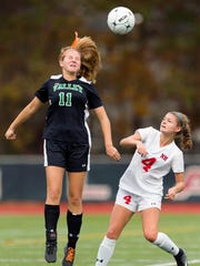 Pascack Valley's Rachel White (11) gets a head up on Northern Highlands' Katie Murray (4) in Monday's North 1 Group 3 high school girls soccer semifinal in Allendale, NJ. Northern Highlands coasted to a 3-0 victory.