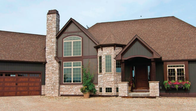 Jason and Casey Lynn Lawrence built their home on family land in Raymond, Wis.