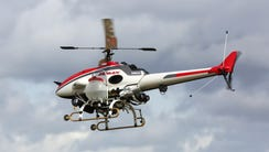 The Yamaha RMax unmanned helicopter takes flight during