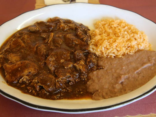 Chicken pipian, in a red Guatemalan mole, is served at Mara's Grill, 3441 N. 84th St.