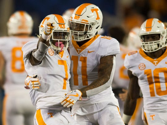 Tennessee defensive back Rashaan Gaulden (7) and Tennessee linebacker/defensive lineman Austin Smith (11) celebrate after recovering a fumble during Tennessee's game against Kentucky at Kroger Field in Lexington on Saturday, Oct. 28, 2017.