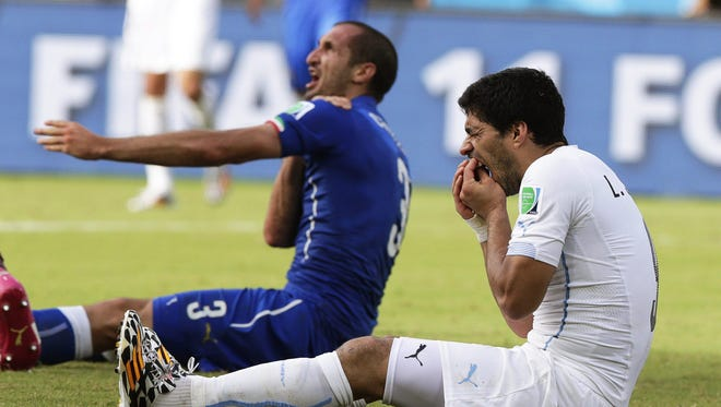 Italy's Giorgio Chiellini, left, was bitten by Uruguay's Luis Suarez at the World Cup on Wednesday.