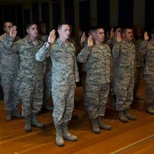 Airmen take the Oath of Enlistment during a reenlistment ceremony in December 2013.