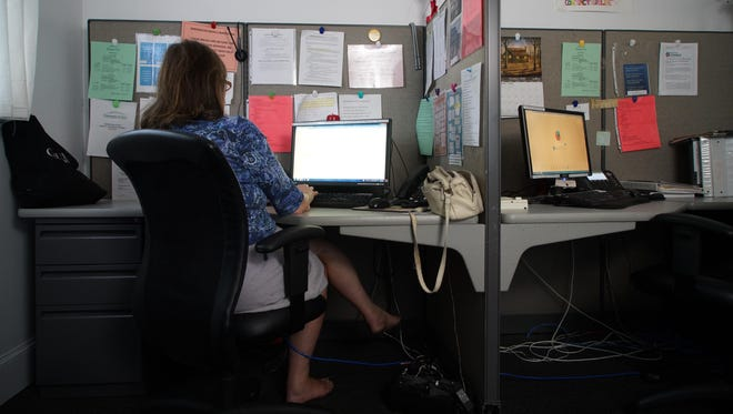 A crisis hotline operator waits for calls at Contact Lifeline, a non-profit agency that handles calls from people with suicidal thoughts and victims of sexual assault. The National Sexual Assault Hotline saw a 33 percent increase in calls in the weekend following the release of Donald Trump's comments on sexual assault of women.