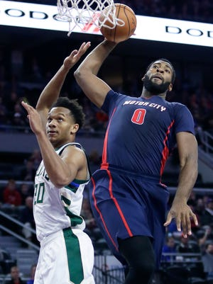 Andre Drummond goes up for a dunk against Bucks guard Rashad Vaughn.