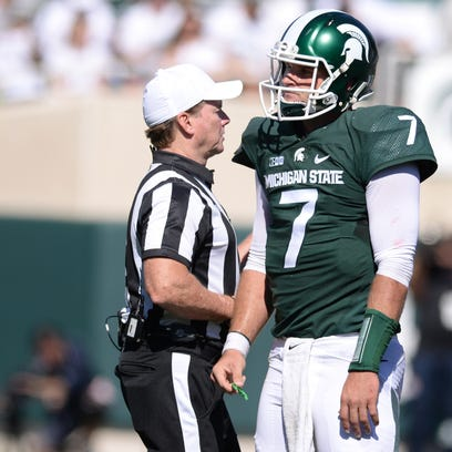 MSU Quarterback Tyler O'Connor reacts after being sacked