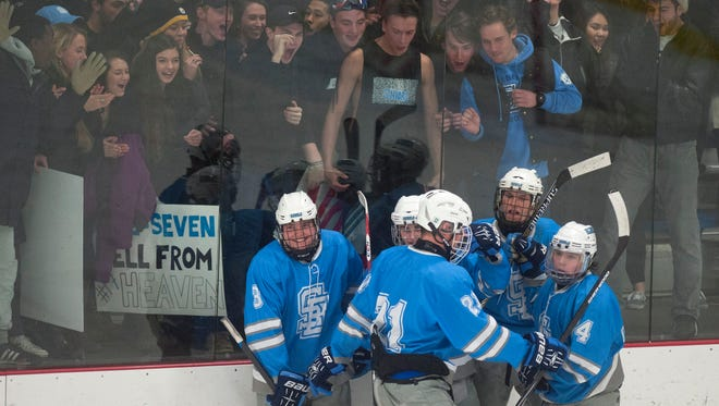 South Burlington players celebrate Kyle McDonald's third-period goal in front of the home fans during Wednesday's game against Champlain Valley at Cairns Arena.