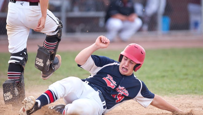 Franklin County's Colby Brouillette slides into home in the seventh inning of the second game of the American Legion baseball championship on Friday in Hartford.