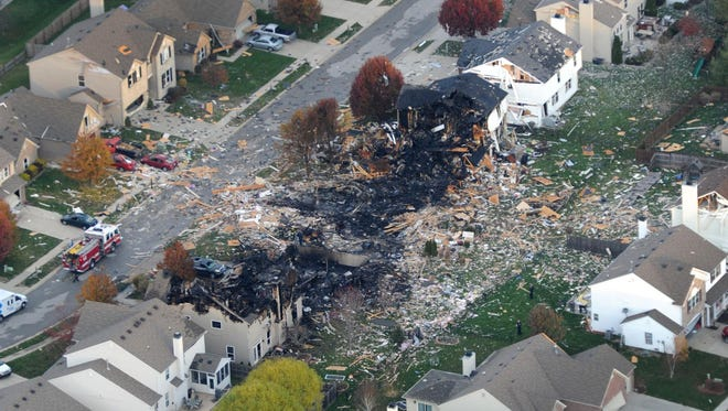 Aerial view shows the two homes that were leveled and the numerous neighboring homes that were damaged from the explosion on Nov. 10, 2012, in the Richmond Hill subdivision, near Stop 11 and Sherman Drive.