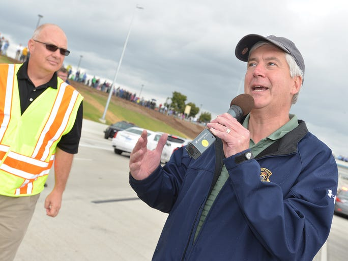 Michigan Gov. Rick Snyder announces I-96 will open Monday morning before a ribbon-cutting ceremony during family fun day along a newly constructed section of I-96 on Sunday, Sept. 21, 2014, in Livonia.