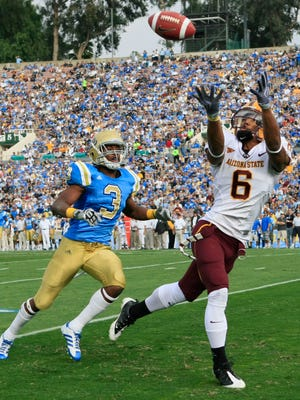 Arizona State's Kyle Williams makes a touchdown catch past UCLA's  Rahim Moore at the Rose Bowl in Pasadena.