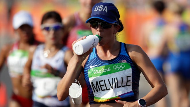 Miranda Melville, of Rush, gets a drink during the women's 20-km race walk at the 2016 Summer Olympics in Rio de Janeiro, Brazil on Friday. She finished 34th.
