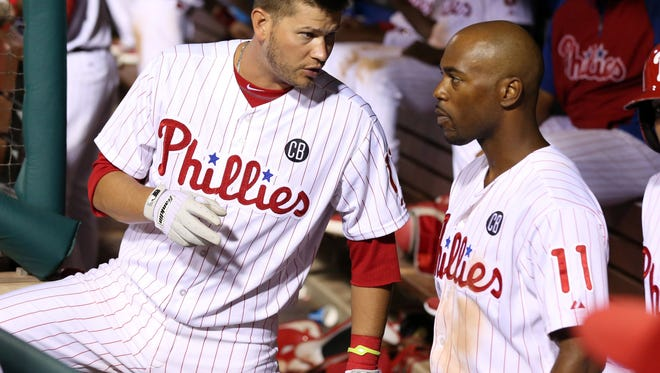 Philadelphia Phillies third baseman Reid Brignac (17) talks with shortstop Jimmy Rollins (11) in the dugout July 21 against the San Francisco Giants at Citizens Bank Park. The Giants won 7-4. Credit: Bill Streicher-USA TODAY Sports