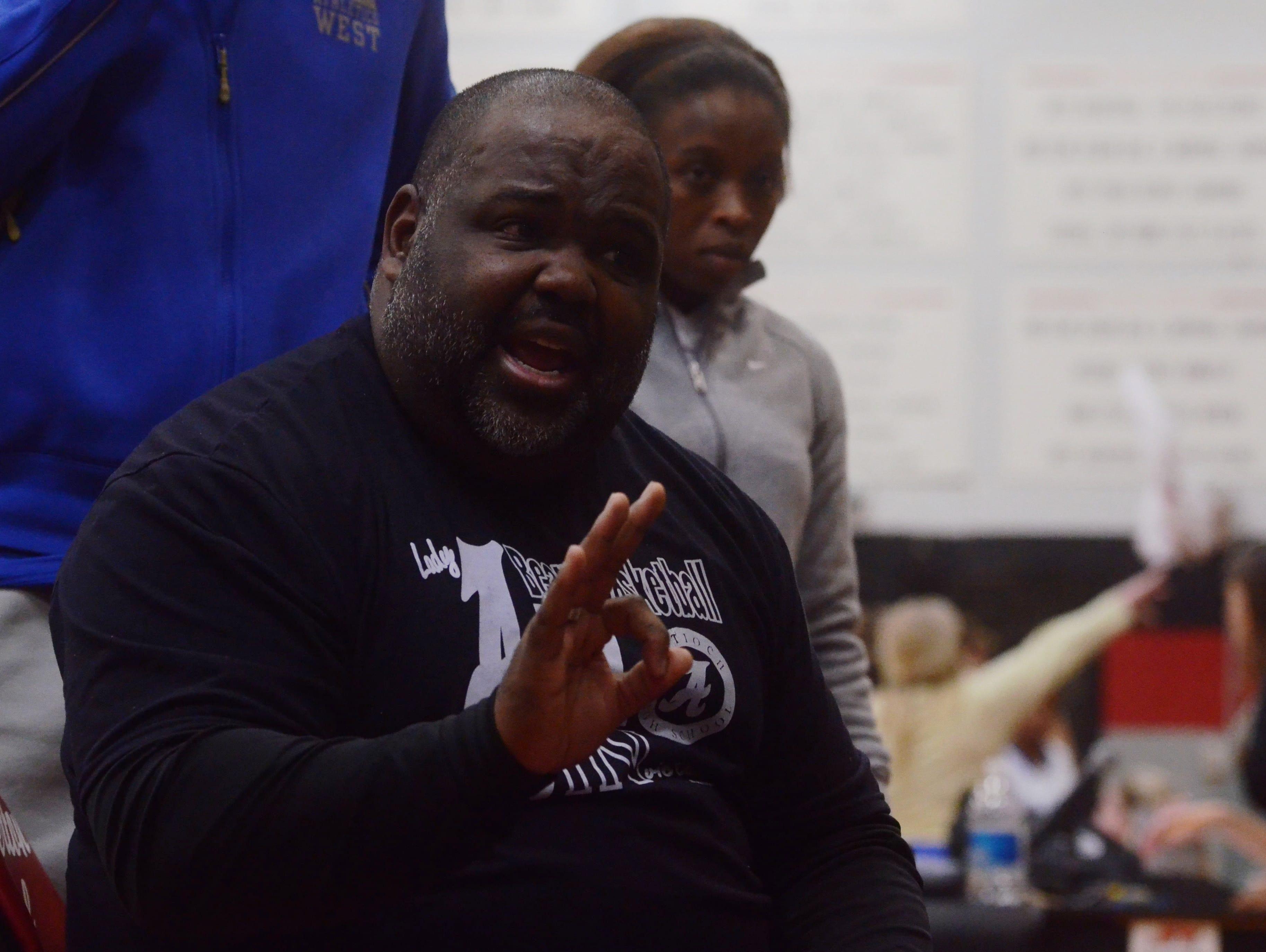 Antioch coach Antoine Buchanan talks to his team during a timeout.