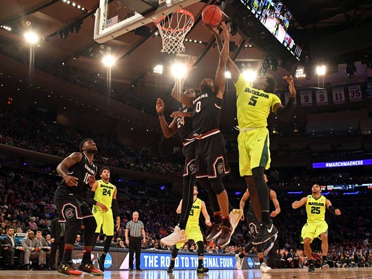 South Carolina Gamecocks guard Sindarius Thornwell (0) and Baylor Bears forward Johnathan Motley (5) go for a rebound during the second half in the semifinals of the East Regional of the 2017 NCAA Tournament at Madison Square Garden.