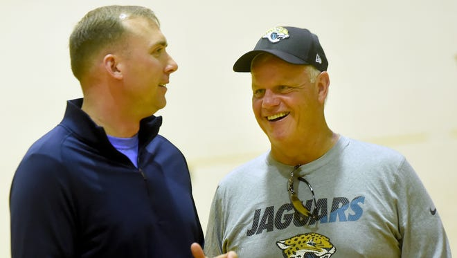 Longtime NFL assistant coach Pat Flaherty, right, comes back to his alma mater Delone Catholic each summer to run a football camp. Last year he invited special guest Major David Borden, left, a Delone grad.