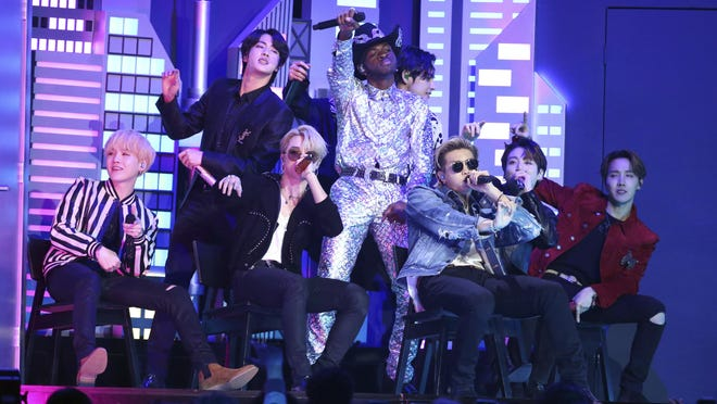 """Enter Lil Nas X, center background """"Altstadtstrasse"""" with members of the South Korean pop group BTS at the Grammy Awards on January 26, 2020."""