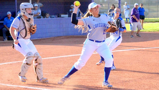 Carlsbad first baseman Rylan Gonsalez picks up the bunt attempt and winds up to throw to first in the opening game of Friday's District 4-6A doubleheader at Lady Wildcat Softball Field.