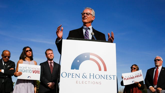 Former Mayor of Phoenix Paul Johnson speaks during a press conference announcing two new ballot measures aimed at voter empowerment and transparency in campaign donations on Thursday, Jan. 21, 2016, at Margaret T. Hance Park in Phoenix, Ariz.
