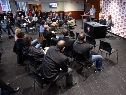 People listen as St. Cloud State University men's hockey coach Brett Larson answers questions during a press conference Friday, April 13, at the Herb Brooks National Hockey Center in St. Cloud.