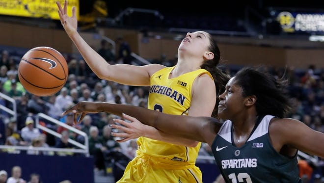 Michigan State forward Nia Hollie (12) fouls Michigan guard Katelynn Flaherty (3) during the second half of U-M's 74-48 win over MSU on Tuesday, Jan. 23, 2018, at Crisler Center.